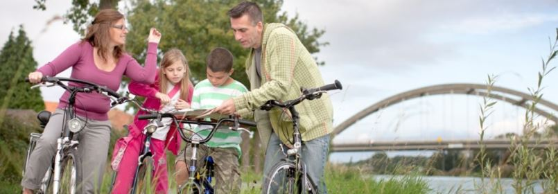 Cycling Tour in Belgium - Family Studying Map