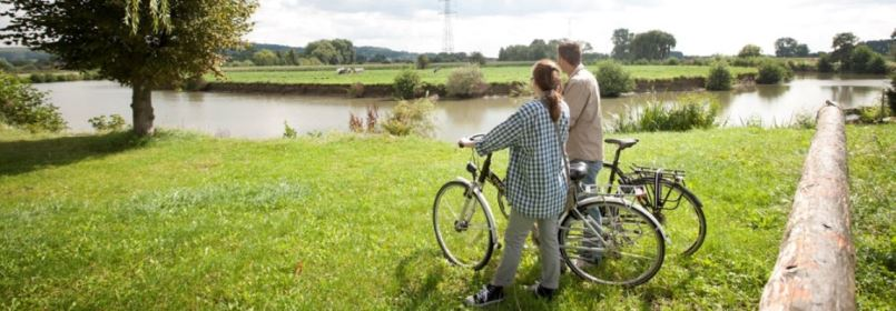 Cycling Tour in Belgium - Couple by River