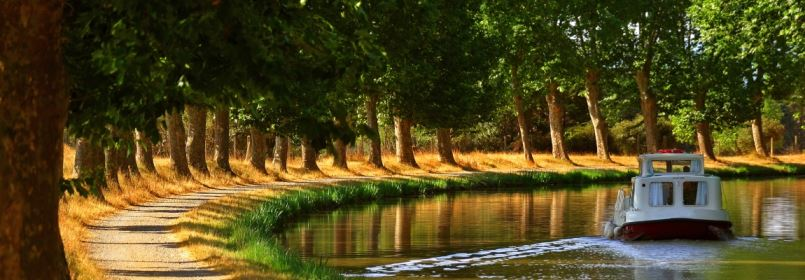 Canal du Midi Cycling Tour - Boat on Canal