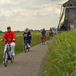 Boat & Bike Tour of Northern Holland - Windmill & Cyclists