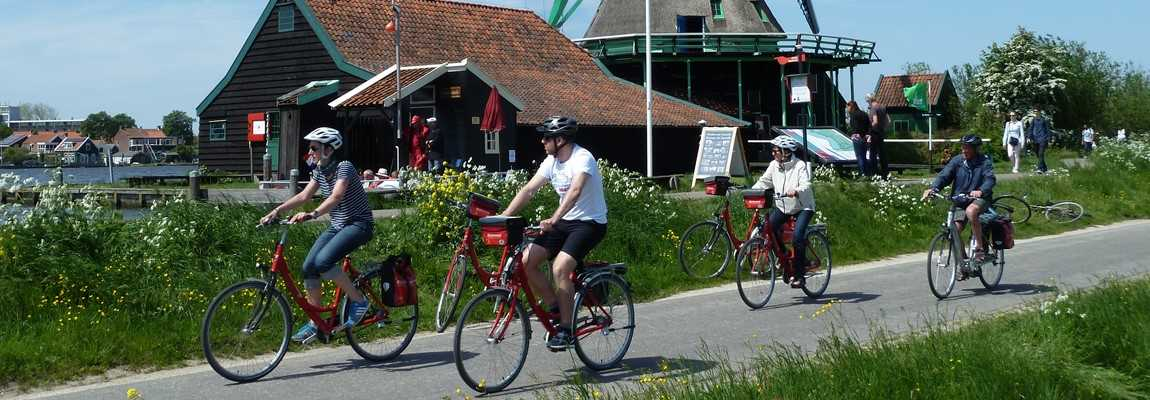 Boat & Bike Tour of Northern Holland - Cyclists & Windmill